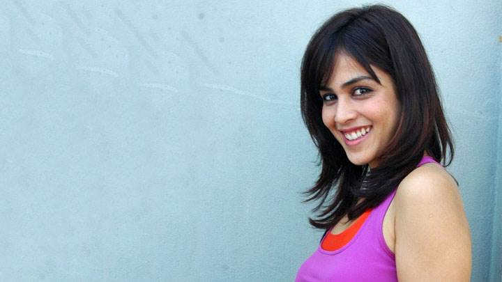 Genelia D'souza Smiling Side Pose In Purple Top